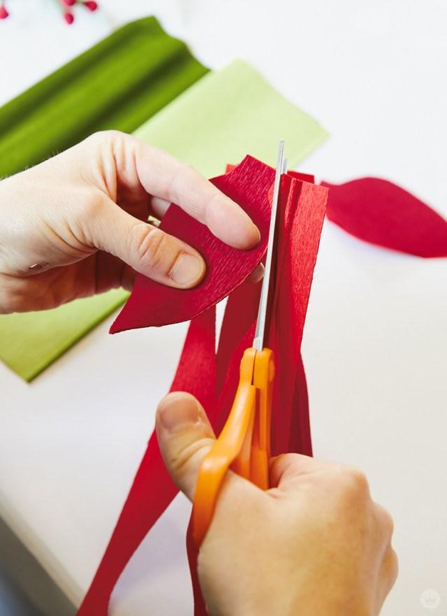 Cutting crepe paper poinsettia petals