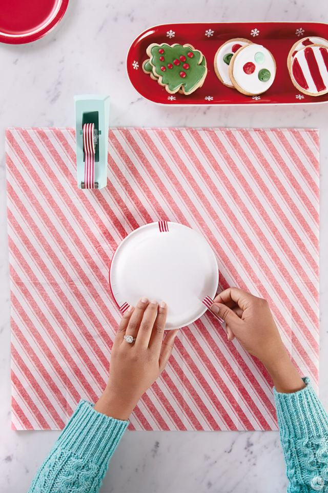Taping plates together to package Christmas cookies