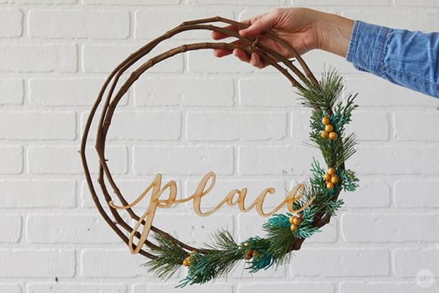 """Modern Christmas wreath ideas: Asymmetrical wreath with laser-cut """"peace"""""""