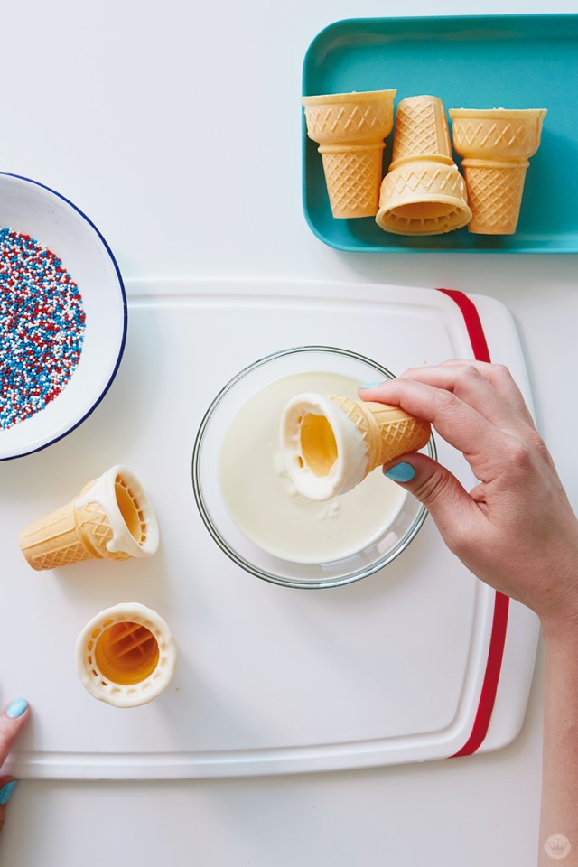 Dipping ice cream cone in melted white chocolate