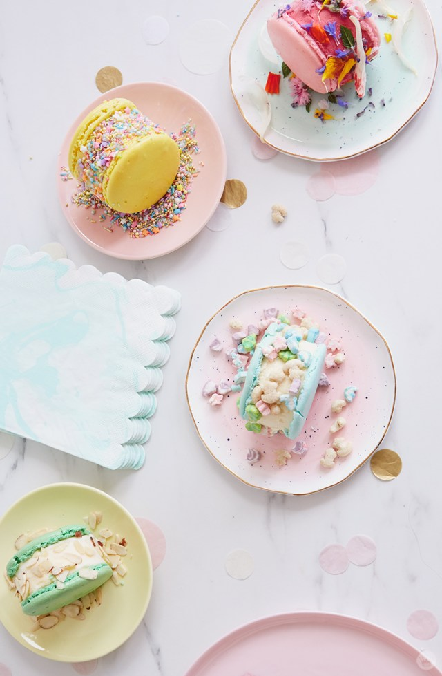 Ice cream sandwiches decorated with edible flowers, fancy sprinkles, cereal with marshmallows, and almond slices