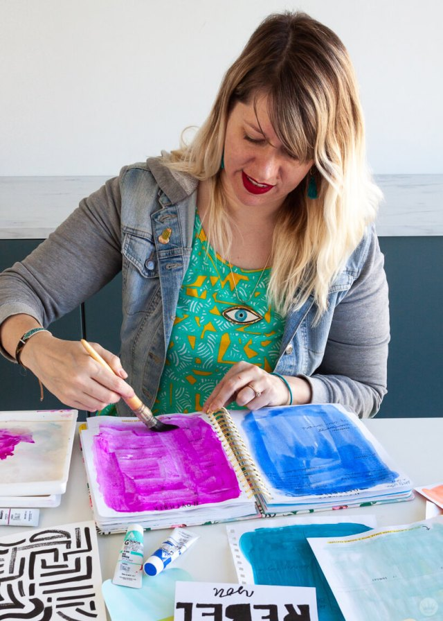 Hallmark artist Kristin S. painting on an old planner | thinkmakeshareblog.com