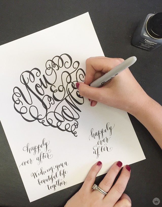 """A Laura Hooper Calligraphy design: a heart featuring the words """"You & Me."""""""