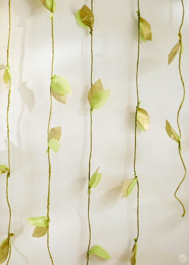 the finished DIY paper vine garland on a wall | thinkmakeshareblog.com
