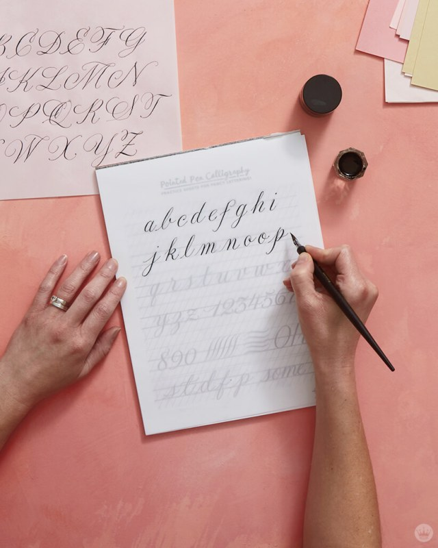 Tracing lowercase calligraphy letterforms with a pointed pen