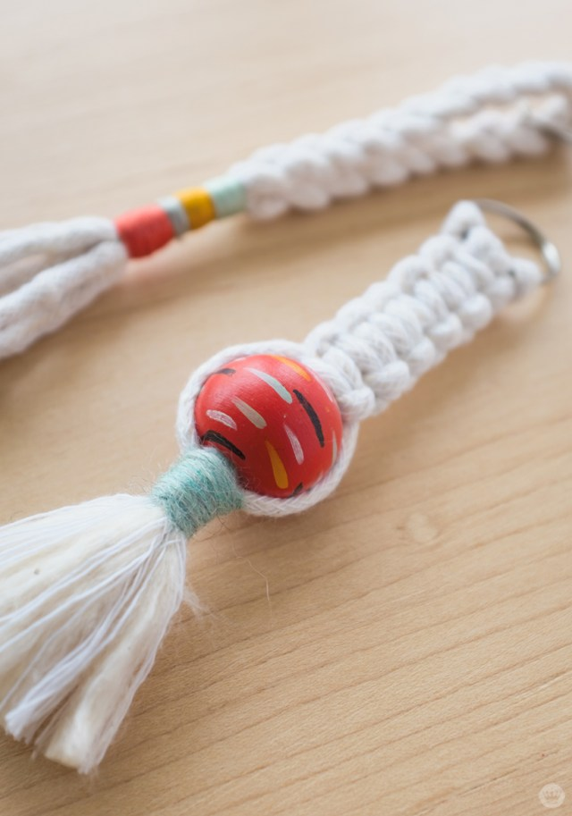 Macramé keychain with hand painted Sculpey bead and wrapped tassel