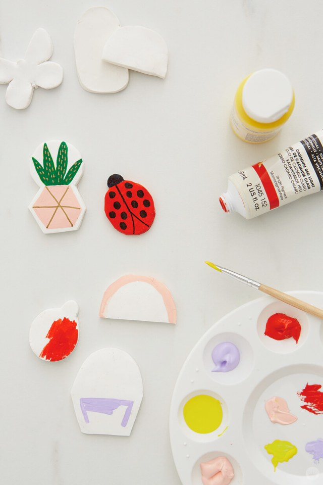 painting the baked clay pins for the DIY Clay gift attachments | thinkmakeshareblog.com