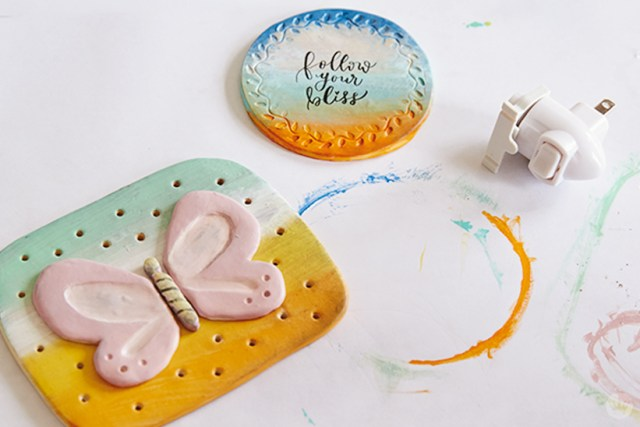 Painted clay polymer night lights ready to mount.