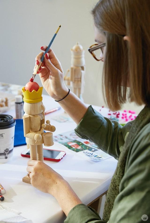 Hallmark artist painting a wooden nutcracker