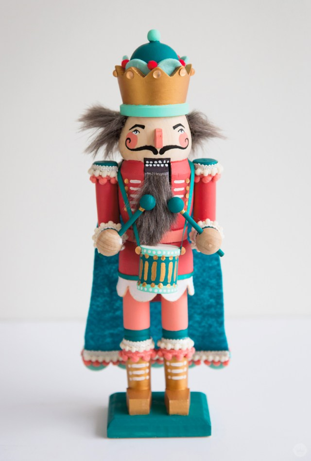 Finished hand painted nutcracker with felt cape