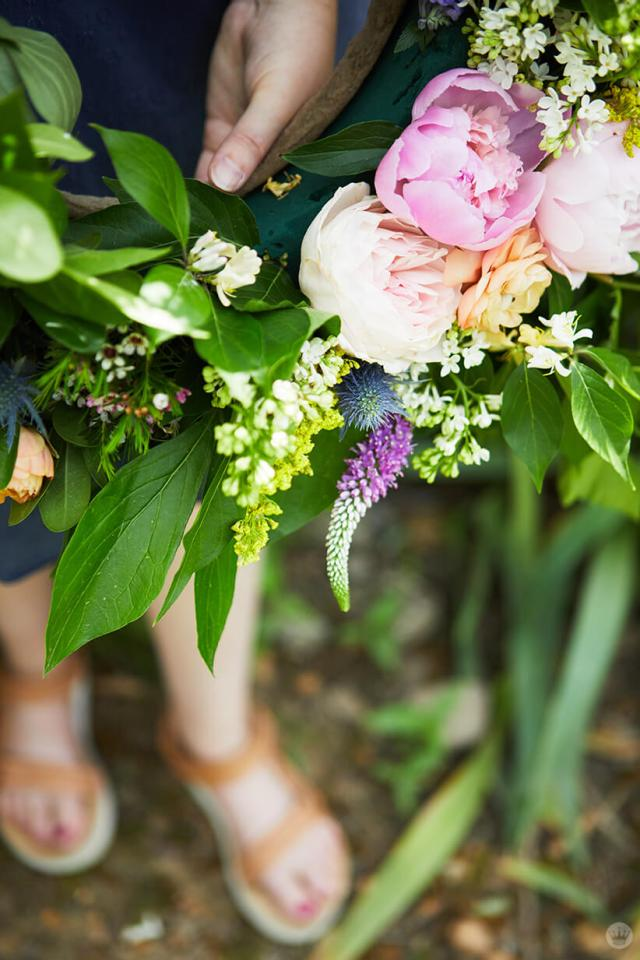 close shot of a floral arrangement with peonies and summer greenery | thinkmakeshareblog.com
