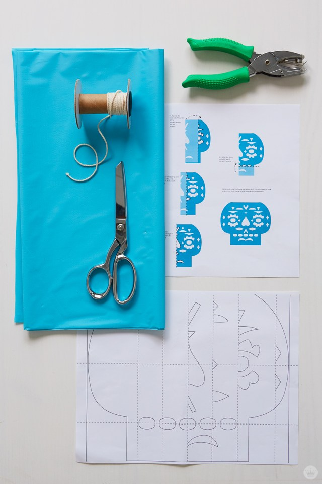 Papel Picado supplies: plastic table cover, string, templates and instructions, scissors, hole punch