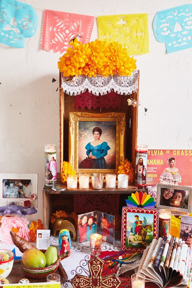 Papel Picado displayed over Day of the Dead altar