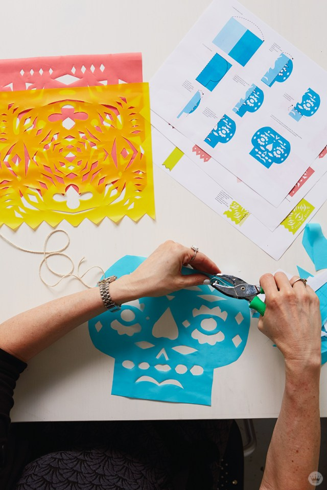 DIY Papel Picado: Hanging banners by punching holes in top corners and threading on to string