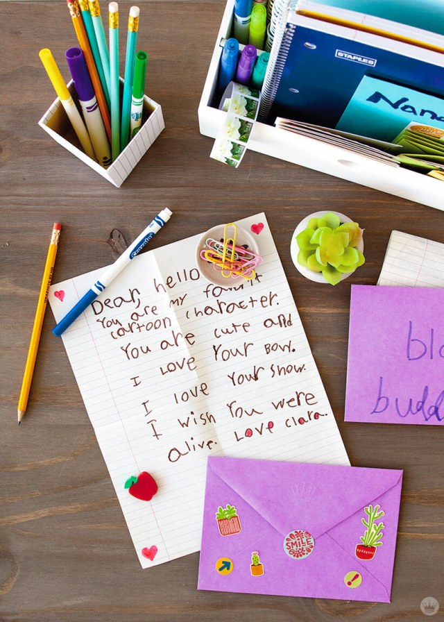 Teaching kids to write letters: Letter-writing station with pens, pencils, paper, stickers, and stamps. Plus Clara's letter to her favorite cartoon character. | thinkmakeshareblog.com
