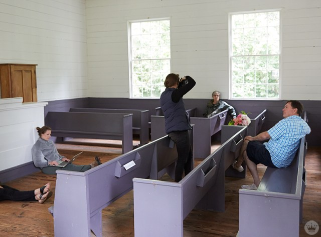 A team from Hallmark photographing flowers in a chapel.