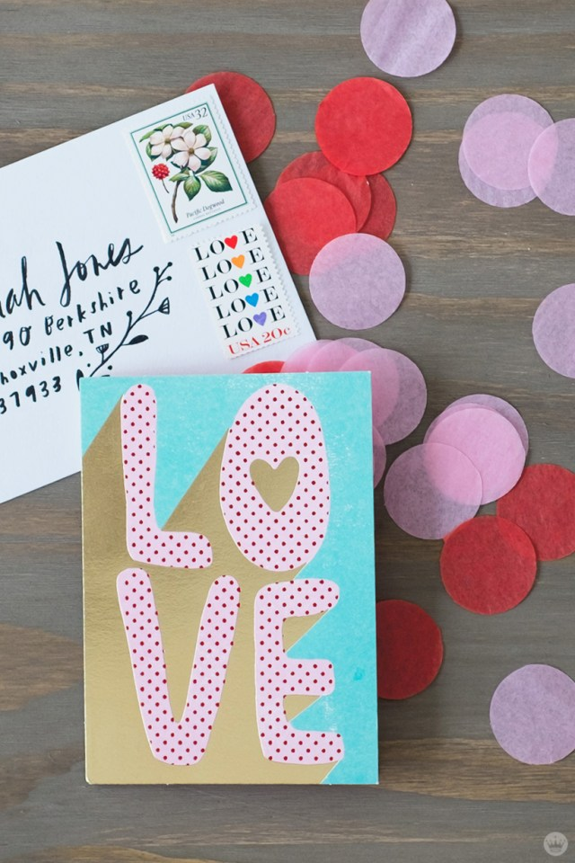 DIY Valentine's Day envelope art: tissue paper confetti and vintage stamps