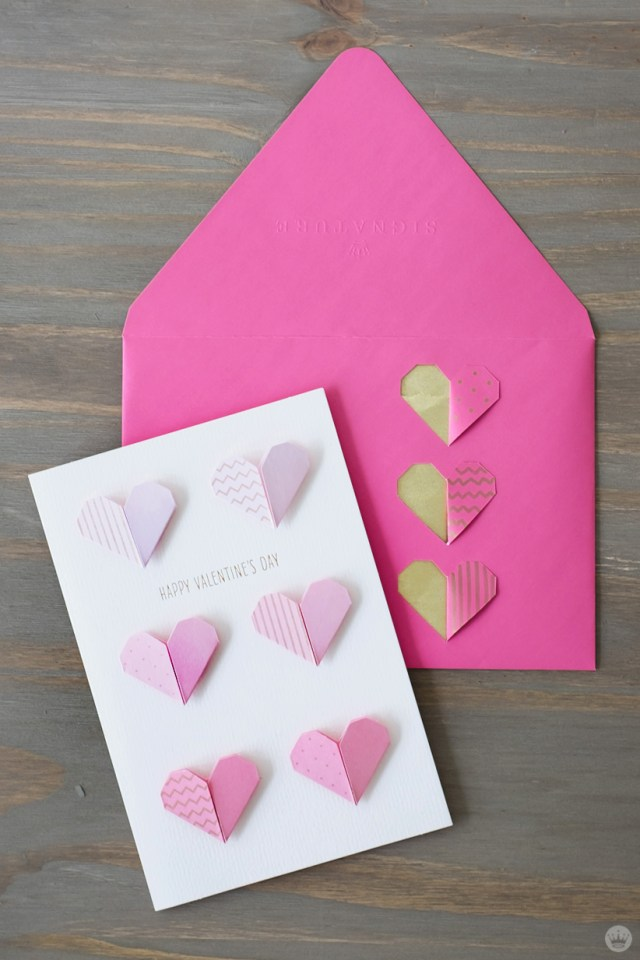 DIY Valentine's Day envelope art: cut paper hearts