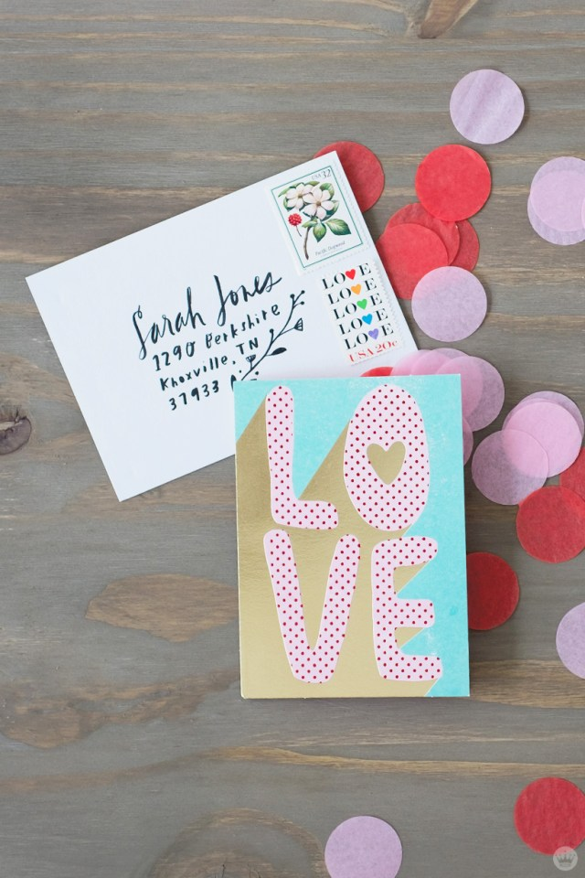 DIY Valentine's Day envelope art: : tissue paper confetti and vintage stamps