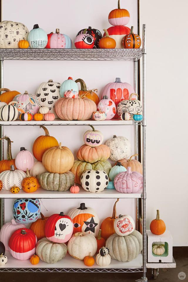 Wire shelving full of painted and natural pumpkins