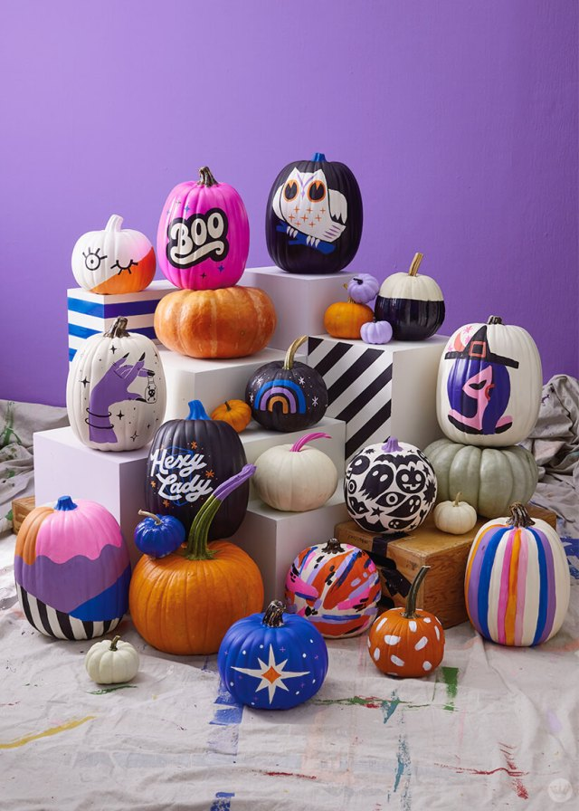 A big pile of pretty painted pumpkins