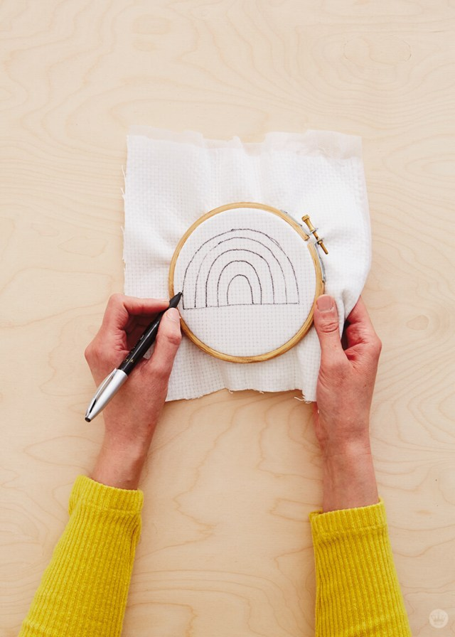 Drawing a pattern for needle punching on fabric in an embroidery hoop| thinkmakeshareblog.com