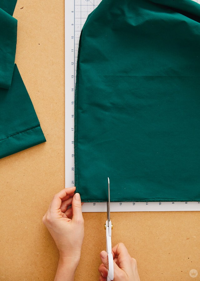 Cutting a square off the corner on the bottom of the pillowcase | thinkmakeshareblog.com