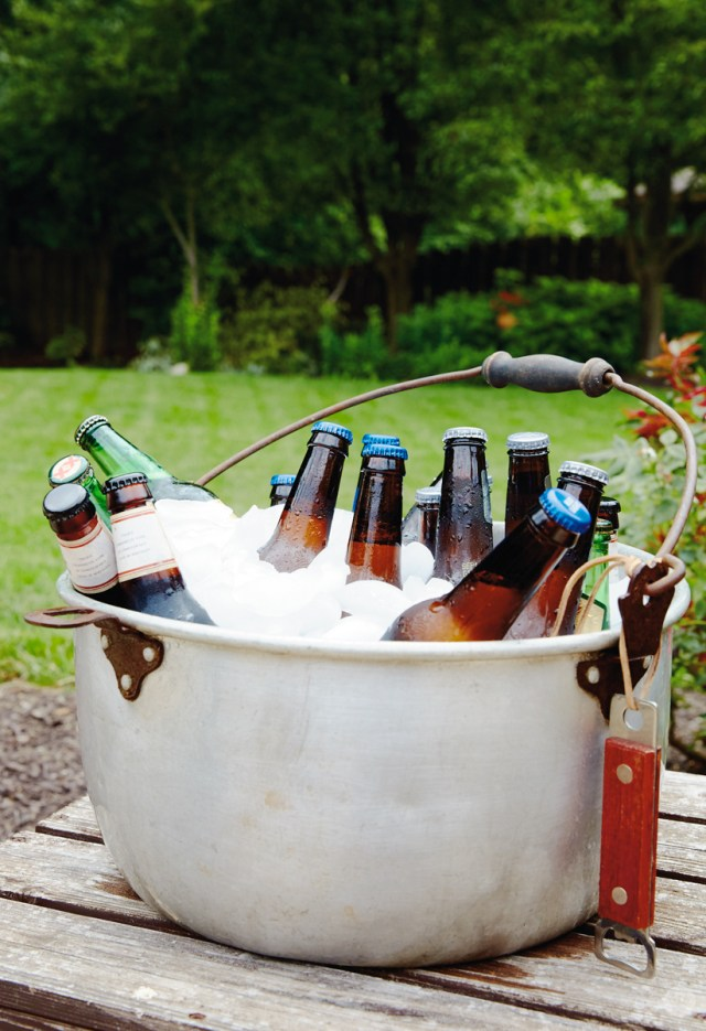 Vintage metal pot filled with ice and beer