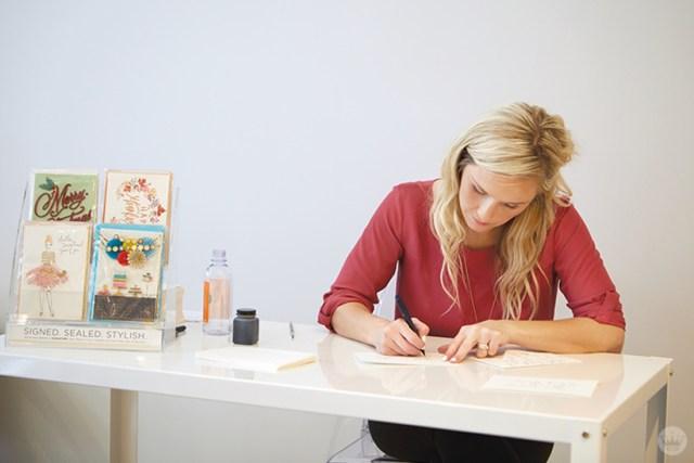 Hallmark Lettering Artist Amber G. addresses envelopes at the new Hallmark Signature Store in Santa Monica, CA