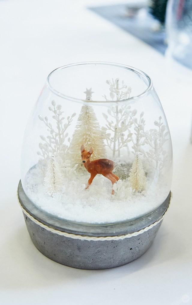 A miniature winter scene inside a lantern