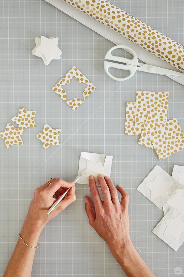 Cutting out the stars for the DIY Star Wall Hanging | thinkmakeshareblog.com