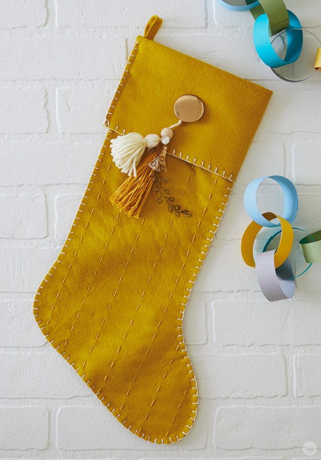 Gold DIY Christmas stocking with vintage button and tassels