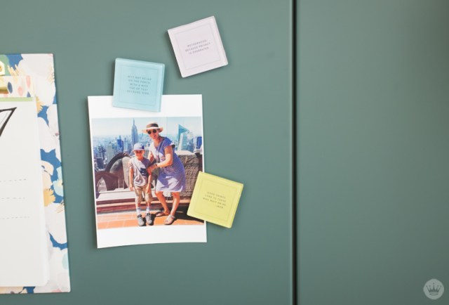 Magnets used to hang photo on refrigerator.