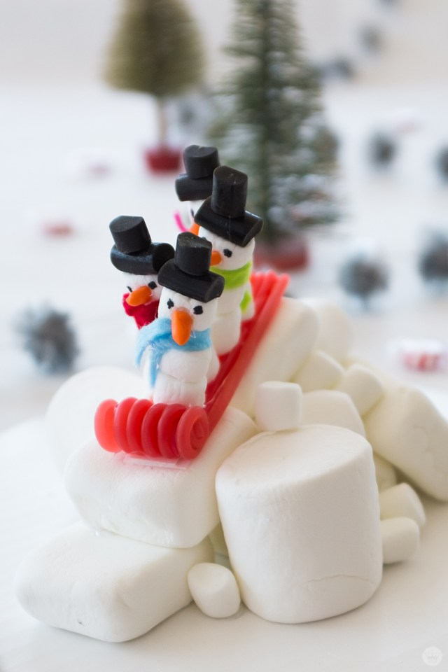 Marshmallow snowmen on a licorice bobsled