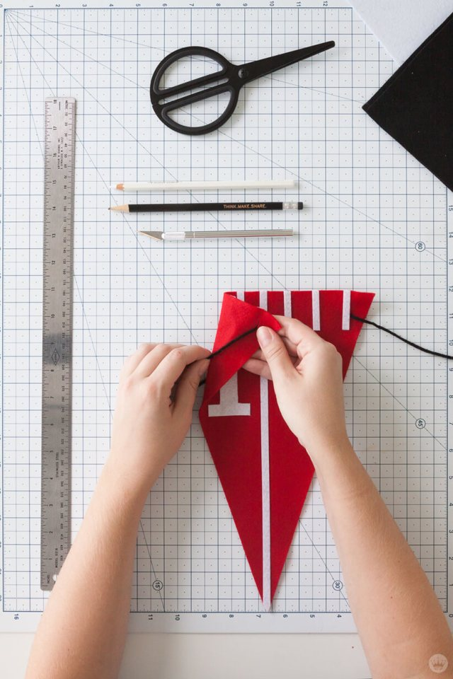 Cutting slits in a DIY Felt Pennant Banner