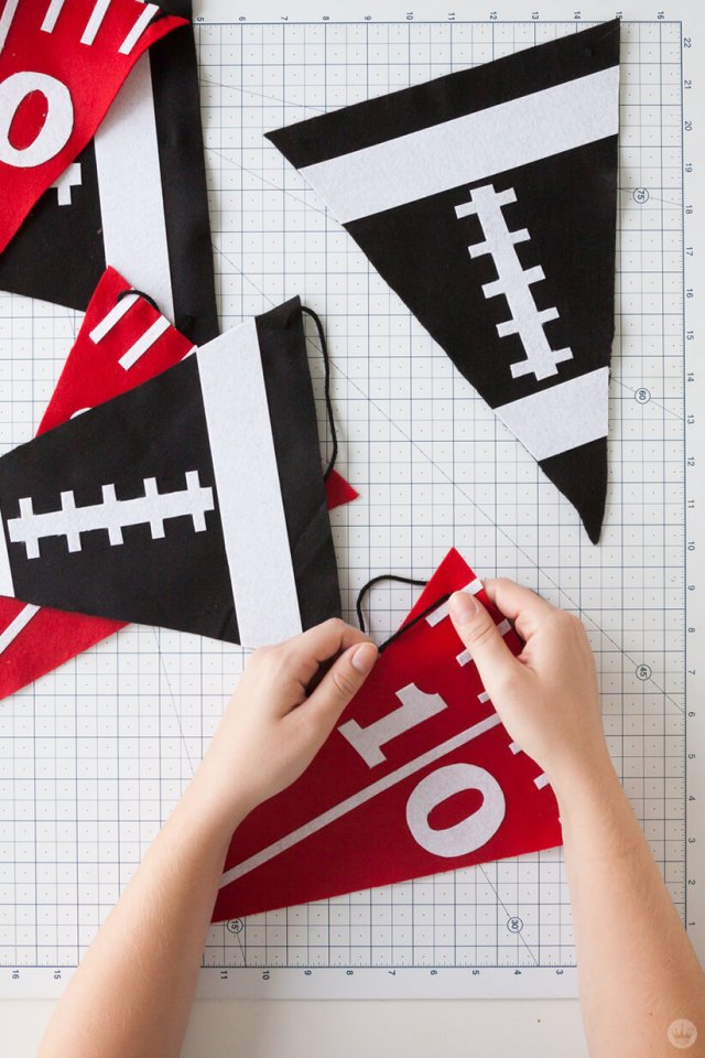 Stringing a DIY Felt Pennant Banner on yarn