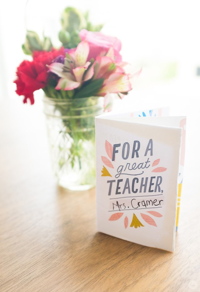DIY teacher gift idea: personalized zine shown with a flower arrangement in a jelly jar.