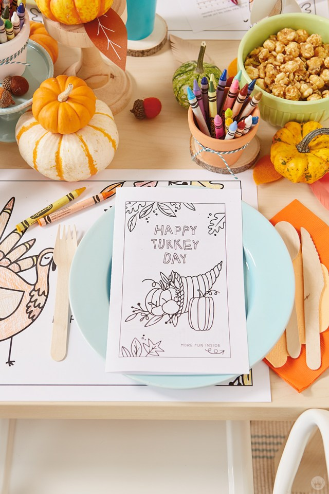 Thanksgiving Kids' Table Crafts: Free printable activity book at a place setting