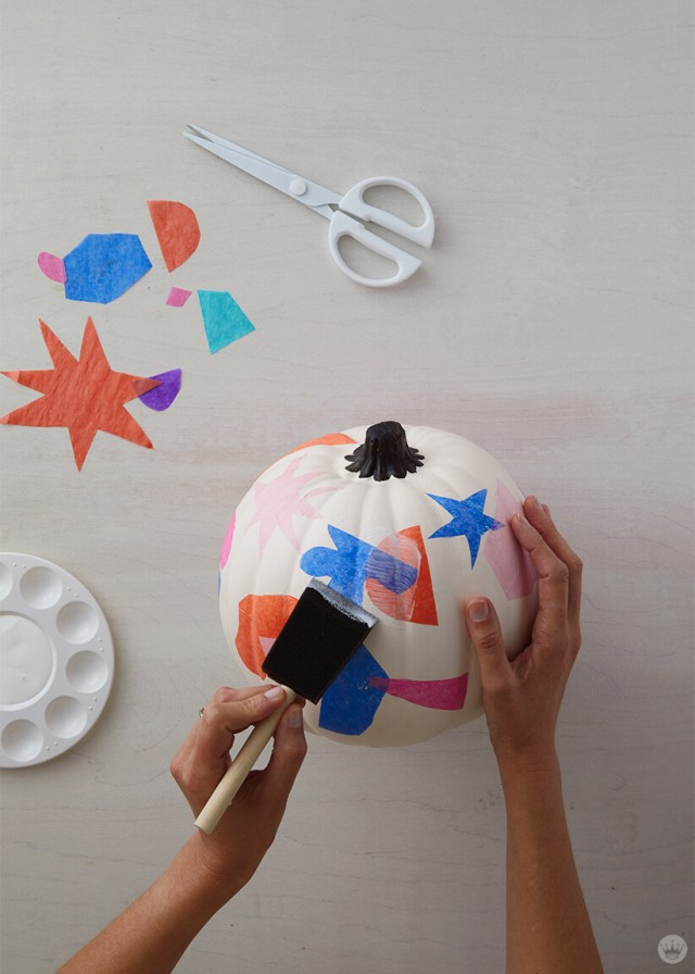 Decoupaging tissue paper on to pumpkins | thinkmakeshareblog.com