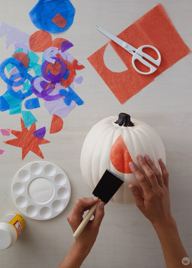 Adding a tissue paper shape to a craft pumpkin | thinkmakeshareblog.com