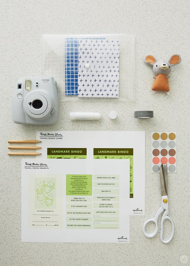 Supplies for travel game pack: Zipper pouch or plastic envelope, small stuffed toy, instant camera, glue stick, washi tape, small pencils, dot stickers scissors, free printable downloads