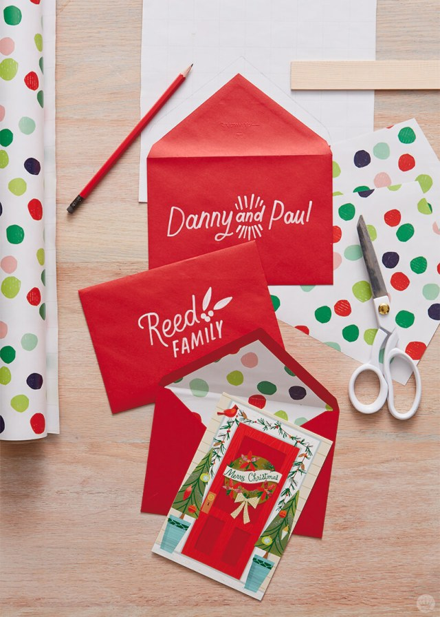 Red Christmas card envelopes with DIY gift wrap liners