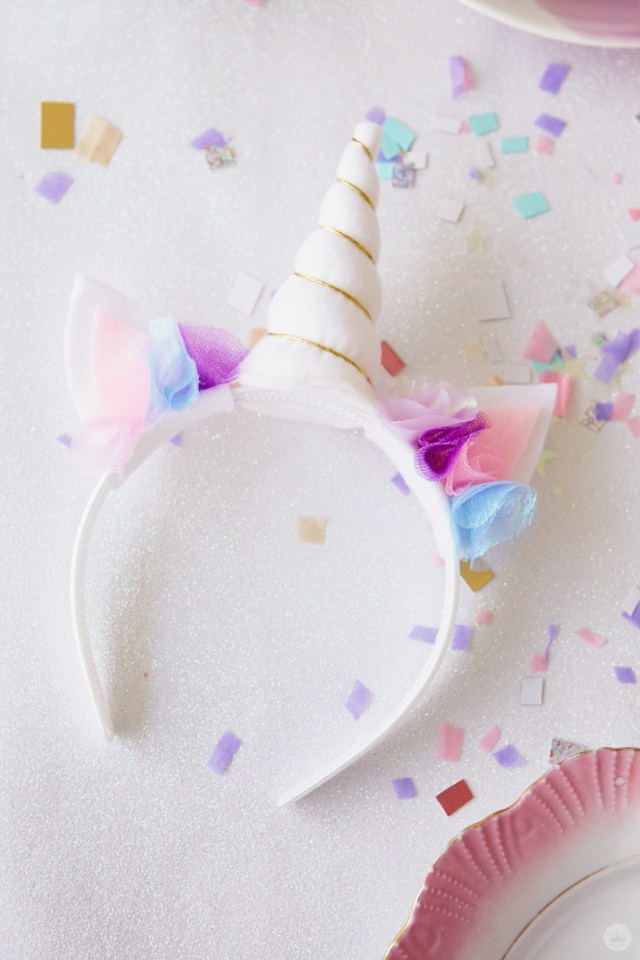 Headband decorated with unicorn horn and ears