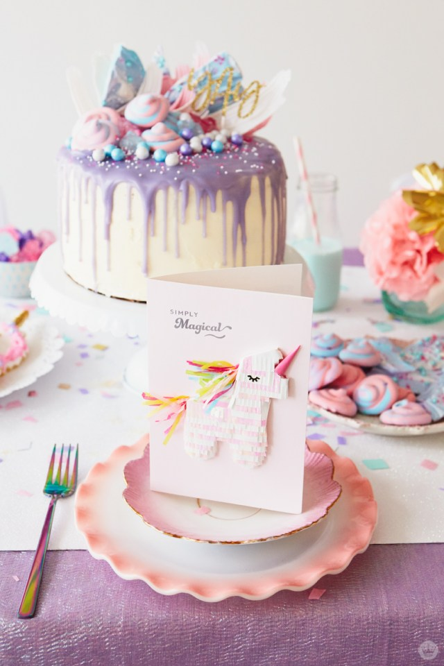 Hallmark Signature unicorn birthday card as place setting on pink-rimmed china