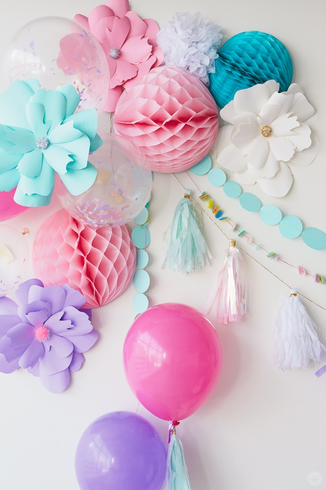 Unicorn Party wall decor: balloons, paper flowers, honeycomb balls, garlands