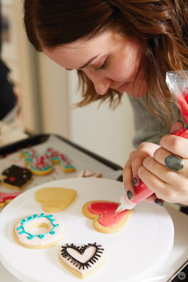 Adding details to a sugar cookie with royal icing