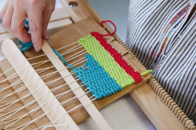 Weaving workshop: hallmark artists learn to weave on cardboard looms