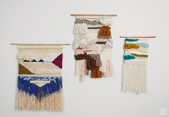 Weaving workshop: finished pieces of fiber art in various palettes with tassels and roving