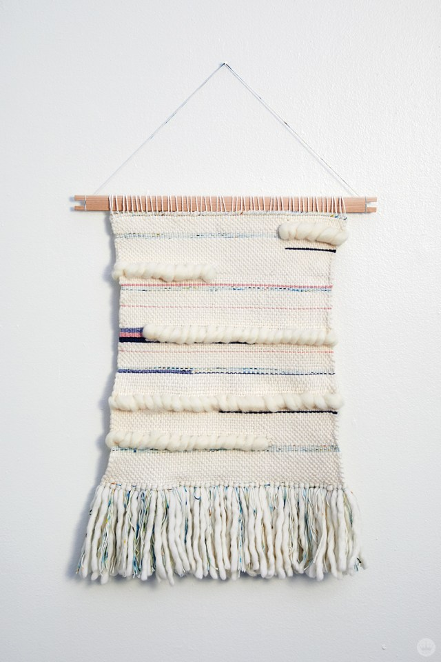 Weaving workshop: large finished fiber art piece in monochromatic color palette