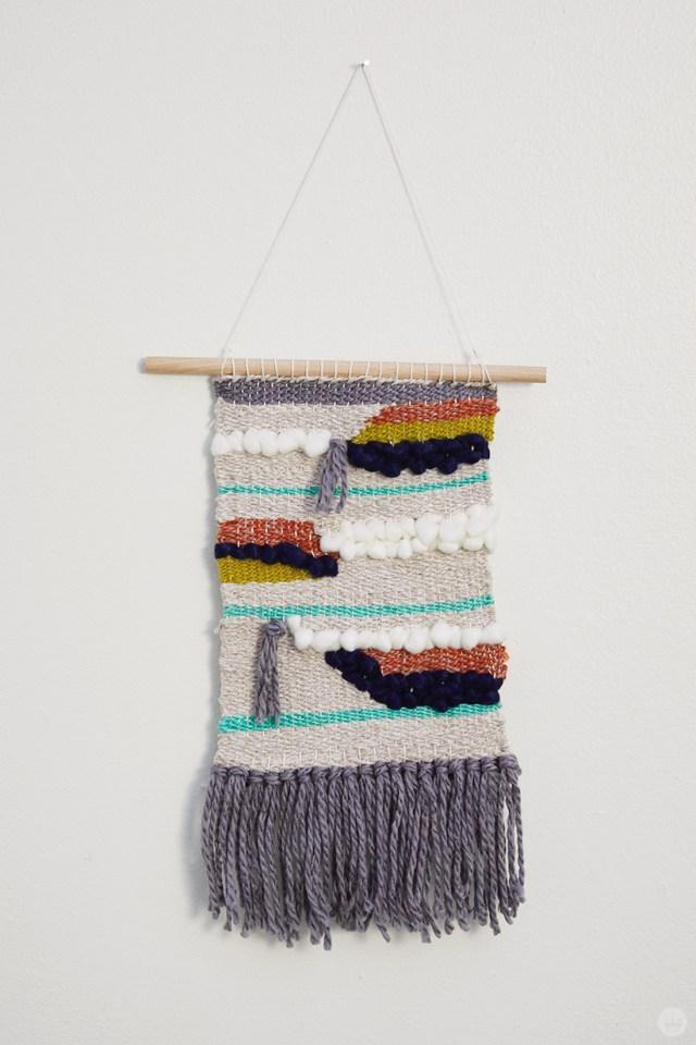 Weaving workshop: finished piece of fiber art in bold color palette